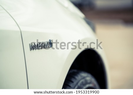 Close up view of a hybrid car Royalty-Free Stock Photo #1953319900