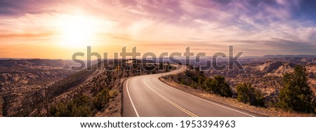 Panoramic View of a scenic route on top of a mountain ridge in the desert. Colorul Sunset Sky Art Render. Taken on Route 12, Utah, United States of America. Royalty-Free Stock Photo #1953394963