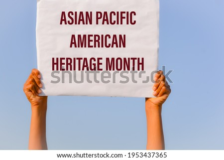 Asian Pacific American Heritage Month with banner in hand in sky background Royalty-Free Stock Photo #1953437365