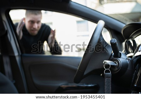 Car Key Lockout. Forgot Inside His Vehicle Royalty-Free Stock Photo #1953455401