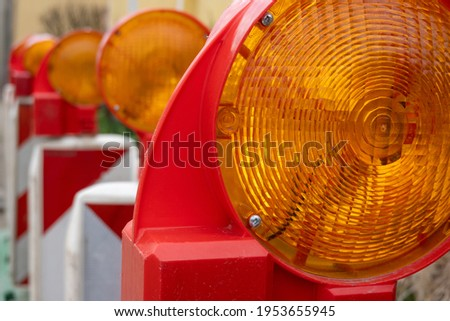 Warning lights at a construction site  Royalty-Free Stock Photo #1953655945