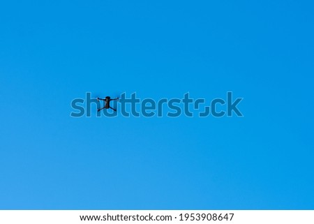 Unmanned quadcopter with high definition digital camera in the blue sky.