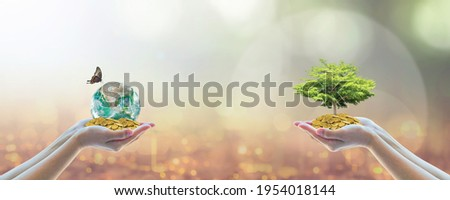 Environment, social, governance (ESG) and CSR sustainable global business investment in clean industry concept with volunteer hands holding world green tree. Element of the image furnished by NASA. Royalty-Free Stock Photo #1954018144
