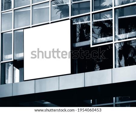 Mock up square Sign logo Signboard shop display on modern building