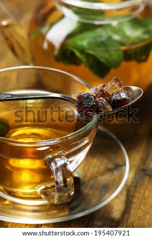 Composition of fresh mint tea in glass cup and teapot  on wooden background #195407921