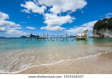 Photo of a beautiful beach at Stingray Bay at Cathedral Cove Marine Reserve, Coromandel Peninsula, New Zealand.