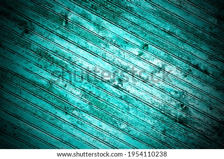 A wooden background with diagonally positioned planks in green colour, pastel tone with light and dark shades, with vignetting