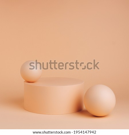 Product podium with ball sphere on pastel orange background. Concept scene stage showcase for promotion, sale, presentation or cosmetic. Minimal monochrome showcase empty mock up template. Royalty-Free Stock Photo #1954147942