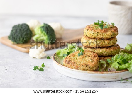 veggie burgers with quinoa, broccoli, cauliflower served with salad. plant based food. space for text Royalty-Free Stock Photo #1954161259