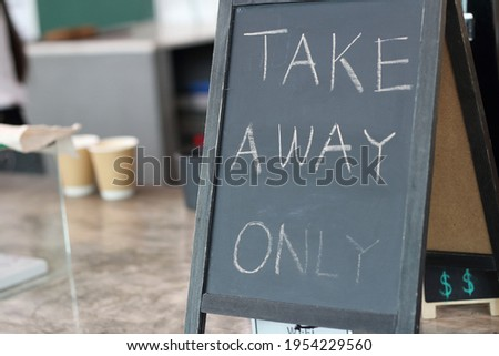 take away only sign on the bar of the modern cafe. cafe only for take away orders. Small business during quarantine concept , owned business , new life, new normal
