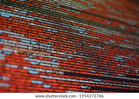 Notebook closeup photo. CSS, JavaScript and HTML usage. Monitor closeup of function source code. Abstract IT technology background. Software source code.