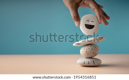 Enjoying Life Concept. Harmony and Positive Mind. Hand Setting White Natural Stone Stack to Balance. Balancing Body, Mind, Soul and Spirit. Mental Health Practice