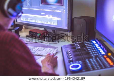 Video editing, recording and cutting room with monitors and sound mixing desk
