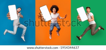 Cool mobile offer. Excited jumping guys demonstrating smartphones with white screens on colorful backgrounds, collage with mockup copy space for your app or website design Royalty-Free Stock Photo #1954344637