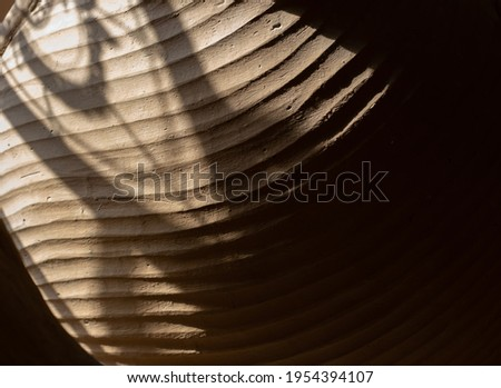 Pattern of texture clay house structure. Wall of soil house and sunlight. Mud background and vintage tone, soft picture