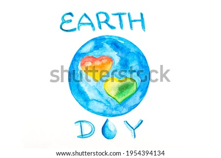 Photography of hand drawn watercolor painting on white paper background. Globe with hearts symbol, world map, ecology green and earth day concept