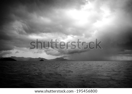 Huge storm clouds with rain over a rough ocean