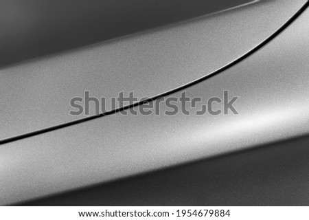 Surface of gray sport sedan, car bodywork, detail of metal fender and hood of modern vehicle, automobile industry, selective focus Royalty-Free Stock Photo #1954679884