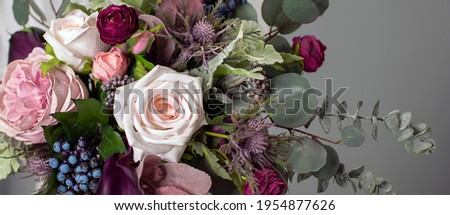 floral background. A long floral banner. Floristics. Purple and green. Colorful bouquet in cool colors. Royalty-Free Stock Photo #1954877626
