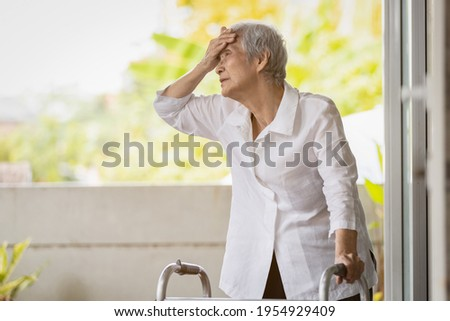 Exhausted senior woman has headache dizziness from the sizzling summer temperatures,old elderly suffering from hot summer weather,symptoms of heat stroke,high temperature on a sunny day,feeling faint Royalty-Free Stock Photo #1954929409