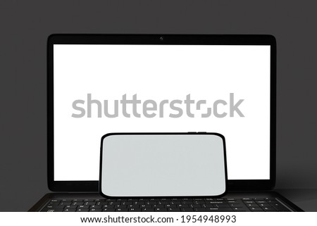 laptop and smartphone with blank screen isolated on black background, clipping path, 3d rendering