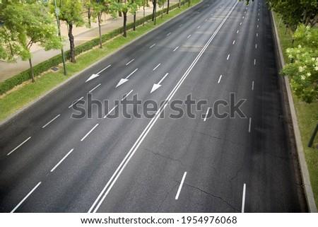 Empty six-lane avenue, no traffic Royalty-Free Stock Photo #1954976068