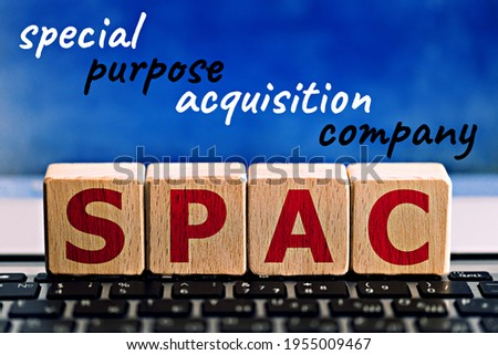 """photo on spac (special purpose acquisition company) theme. wooden cubes with the abbreviation """"spac"""",and the inscription """"special purpose acquisition company"""",on blue background. business concept ima"""
