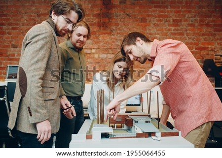 Architect group condemn with blueprints and layout design project at office Royalty-Free Stock Photo #1955066455