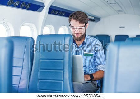 Man doing business in the airplane #195508541