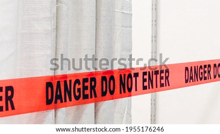 Red band fence danger not enter warning sign Royalty-Free Stock Photo #1955176246