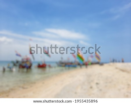 Blurry Picture of Beach Scenery with Beautiful Sky Scape, White Sand, and Anchored Traditional Boats in Gede Island for Background