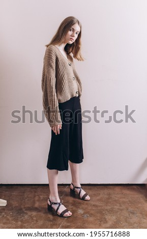 Portrait of young emotional blond caucasian girl in studio on background. Natural beauty, no make up concept