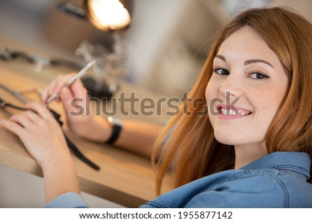 female repairing vintage clocks dismantles watch Royalty-Free Stock Photo #1955877142