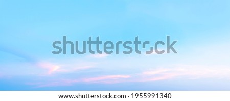 The morning sky looked like a bright golden sky. The sunrise is decorated with clouds in various shapes. Looks beautiful. Royalty-Free Stock Photo #1955991340
