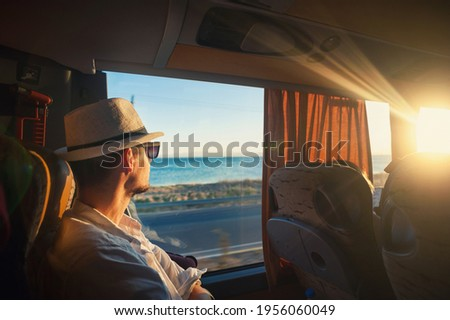 A man is traveling and looking through the bus window during the covid19 corona virus  pandemic Royalty-Free Stock Photo #1956060049