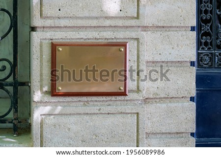 empty copper blank plate on the entrance signboard on textured wall mockup for notary doctor office
