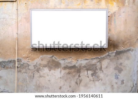 Mock up template concept. Blank sign template horizontal on an old cement wall outside.