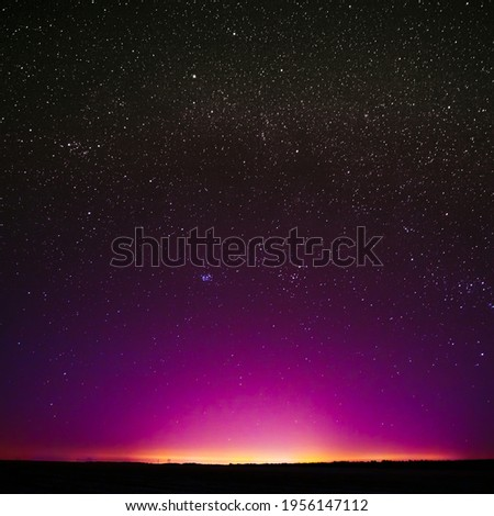 Night Sky Glowing Stars Background Backdrop. Colorful Sky Gradient. Sunset, Sunrise Lights And Colourful Night Starry Sky In Yellow Pink Magenta Orange Purple Violet Colors.