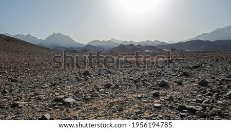 Landscape scenic view of desolate barren rocky eastern desert in Egypt with mountains Royalty-Free Stock Photo #1956194785