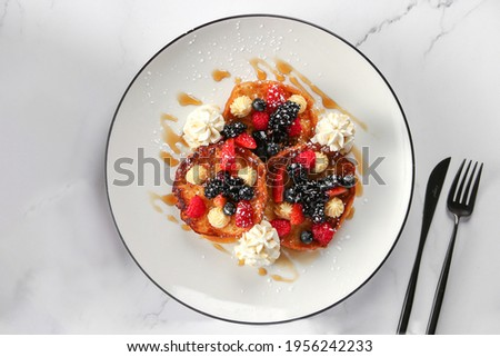 Delicious Pancake with fruits and honey , on white background