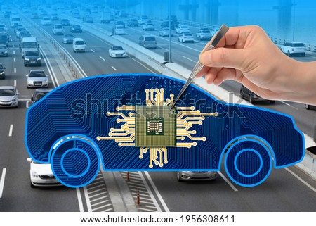Blurry highway background. The hand of a man holding a chip with tweezers in a car illustration. Royalty-Free Stock Photo #1956308611