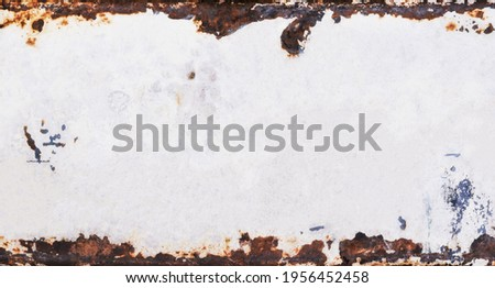 Old metal background with grunge texture and rusted vintage border, white peeling paint and brown grungy rust Royalty-Free Stock Photo #1956452458