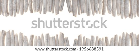Driftwood banner. row of gray sea snags set isolated on white background.Marine nature  background. Marine gray driftwood set.Decor in a nautical style. sea driftwood banner Royalty-Free Stock Photo #1956688591