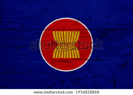 Flag of Association of Southeast Asian Nations. Wooden texture of the flag of Association of Southeast Asian Nations. Royalty-Free Stock Photo #1956828868