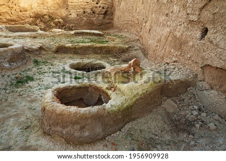 Ruins of the Otrar settlement. Finds of archaeologists. Ruins of an ancient pottery workshop. Ruined houses of ancient people. Middle Asia. History of the Turks. Old buildings in the steppe. Royalty-Free Stock Photo #1956909928
