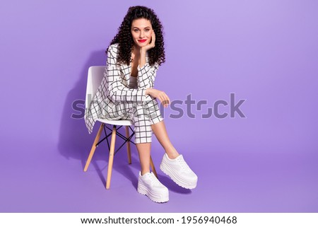Full length photo of young attractive girl happy positive smile sit chair adorable gorgeous isolated over purple color background Royalty-Free Stock Photo #1956940468