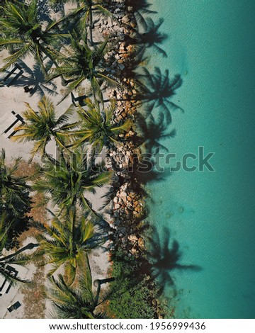 Drone flying above the coastline  Royalty-Free Stock Photo #1956999436