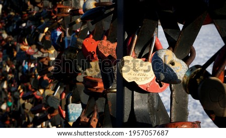 Love Padlocks Lockers at the bridge in Russia. People have place padlocks on the fence symbolizes forever love.
