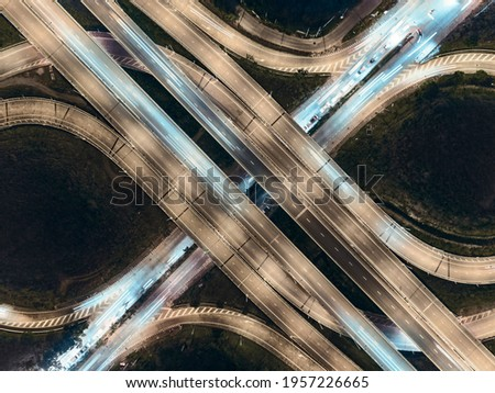 aerial top view road multi lenses on car at night.
