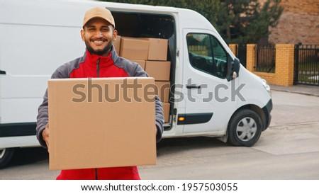 Portrait of indian man delivering parcel. High quality photo